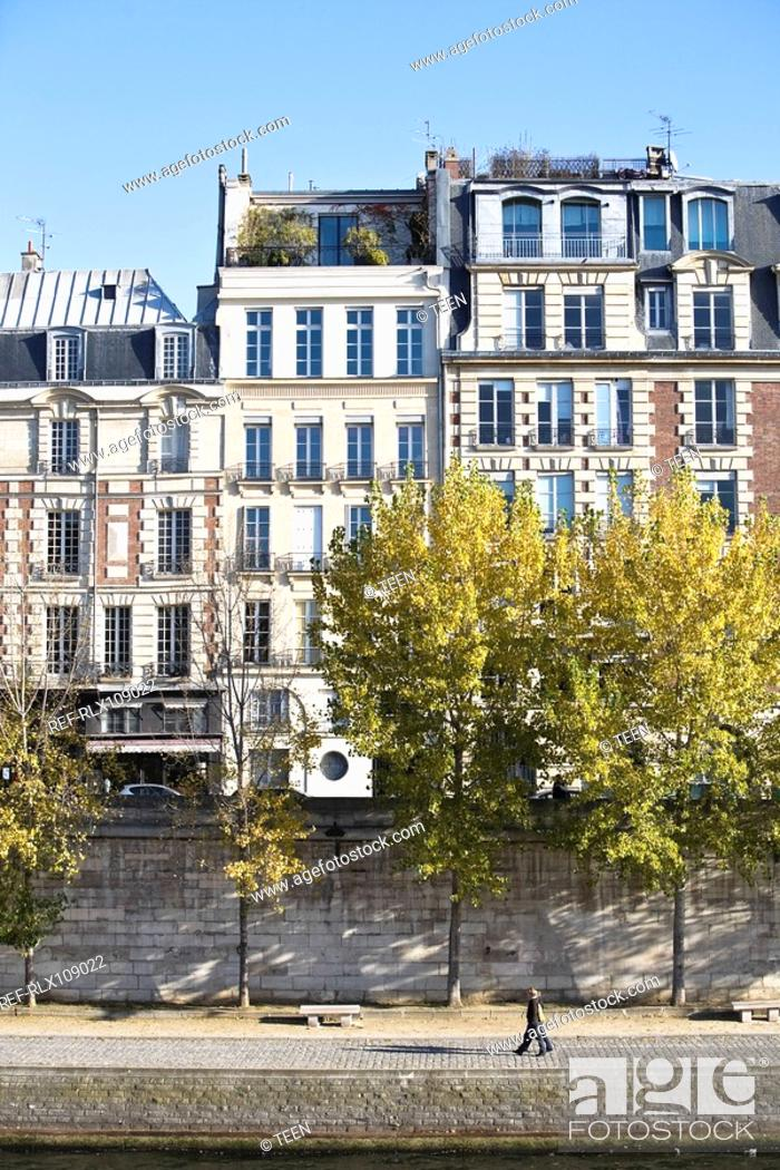Stock Photo: Facade of apartment houses by river Seine, Paris, France.