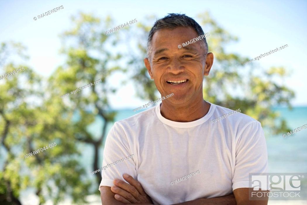 Stock Photo: Mature man smiling.