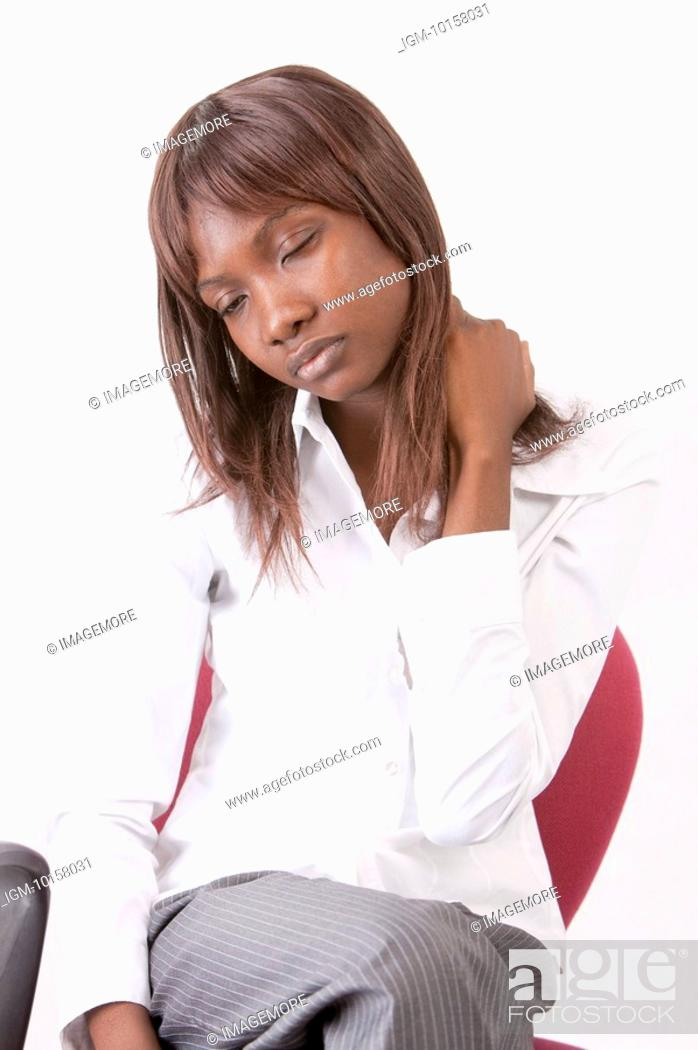 Stock Photo: Young woman resting on chair with eyes closed.