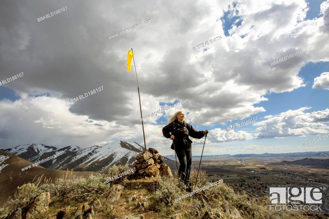 Stock Photo: Caucasian woman standing on remote hilltop.