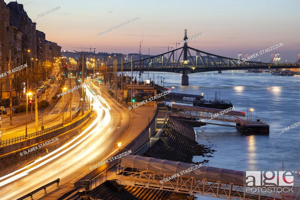 Stock Photo: Dawn on the Danube in Budapest, Hungary. Freedom Bridge in the distance.