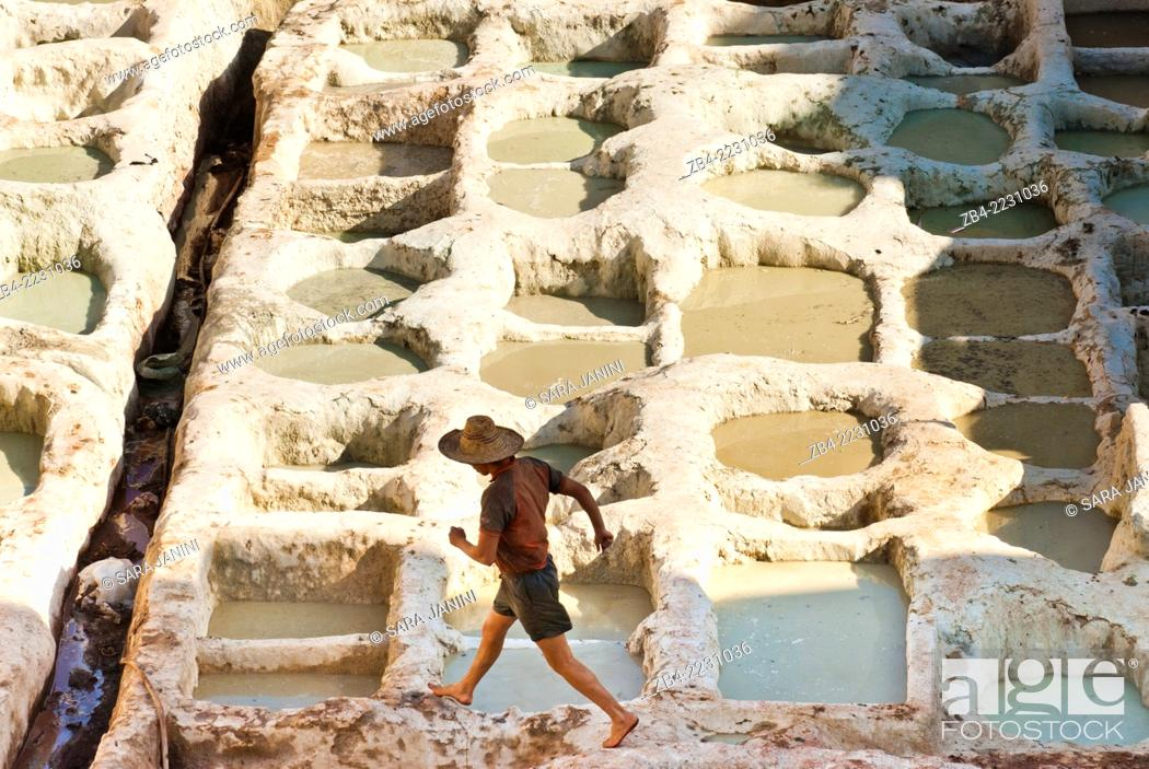 Stock Photo: Worker at the Chouwara Tannery, Fez or Fes, Morocco, North Africa.