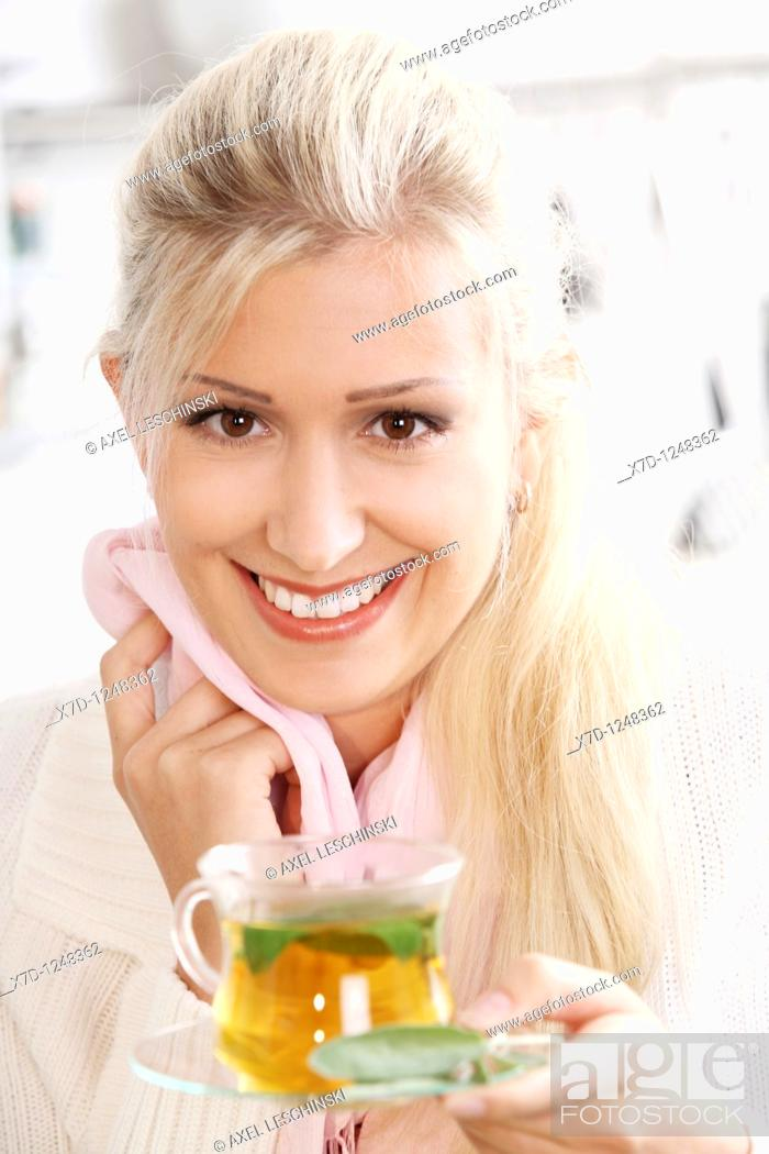 Stock Photo: woman drinking a cup of tea.