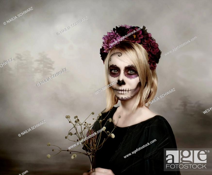 Stock Photo: Portrait of woman with sugar skull makeup.