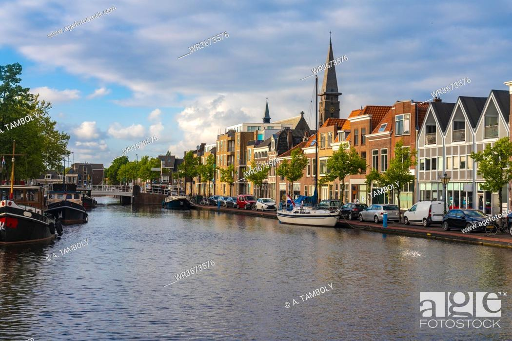 Stock Photo: Netherlands, South Holland, Leiden, Townhouses and canal by Herengracht street.