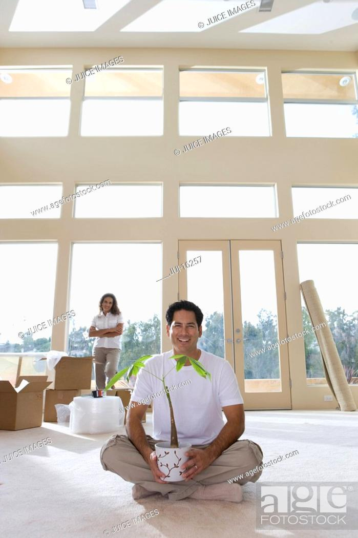 Stock Photo: Couple moving things into new home.