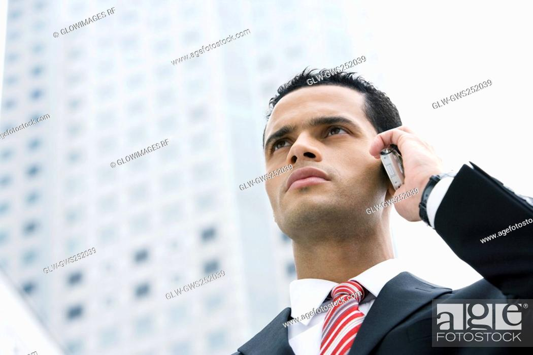 Stock Photo: Close-up of a businessman using a mobile phone.