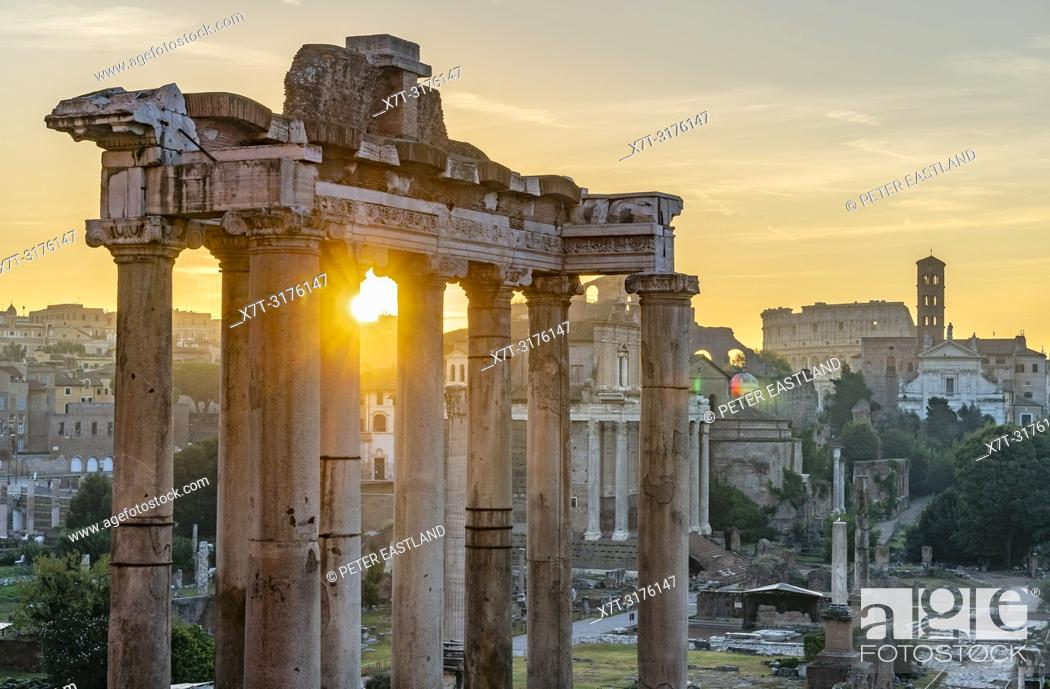 Stock Photo: Looking across The Roman Forum at dawn, from the Capitoline Hill, with the temple of saturn in the foreground and the Colosseum in the distance, Rome, Italy.