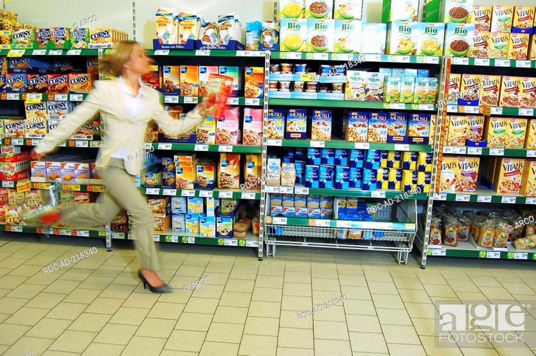 Stock Photo: Woman running in supermarkt, hectic, hurry.