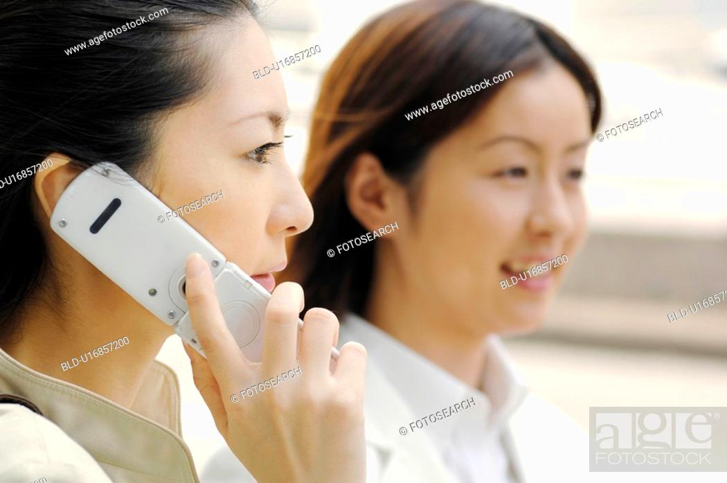 Stock Photo: Business lady who speaks with the cell phone.