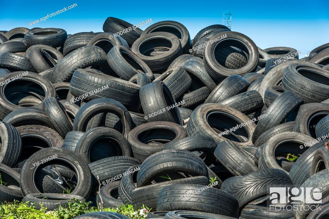 Stock Photo: Old vehicle tyres dumped in piles. not biodegradable ...