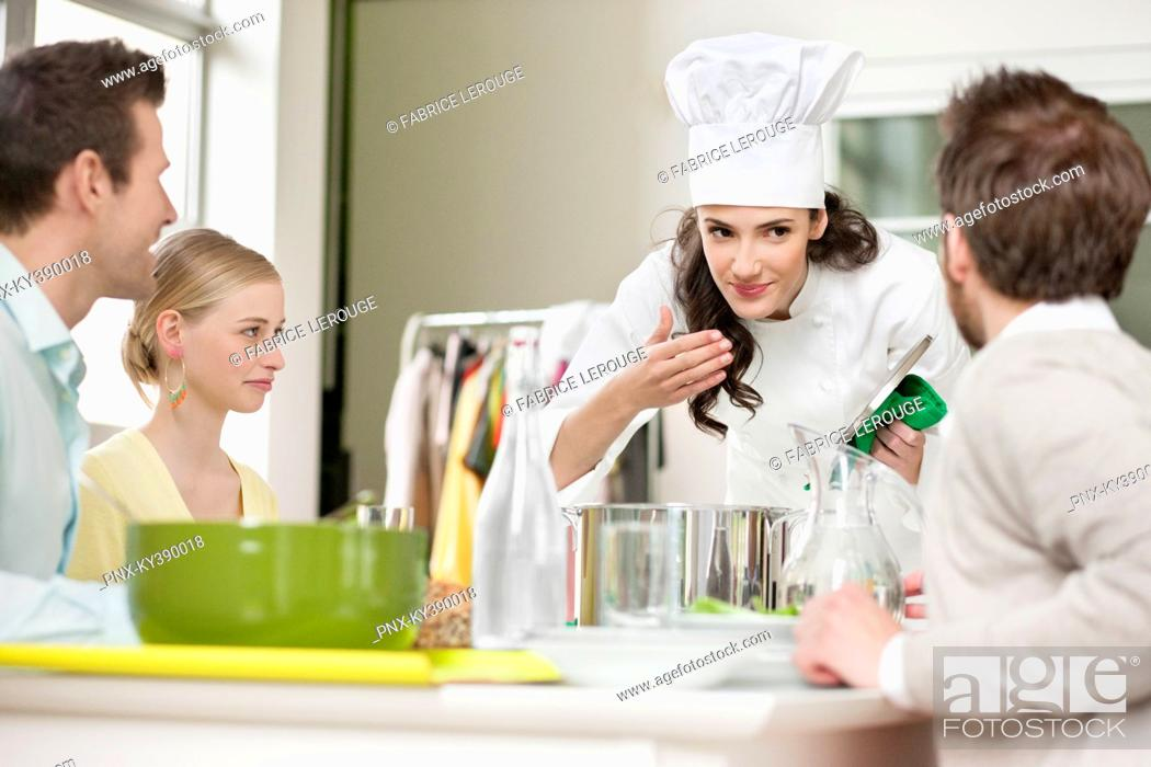 Stock Photo: Female chef smelling food before serving.