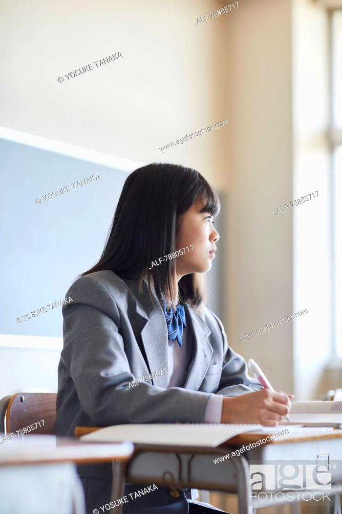 Stock Photo: Mixed-race student in the classroom.