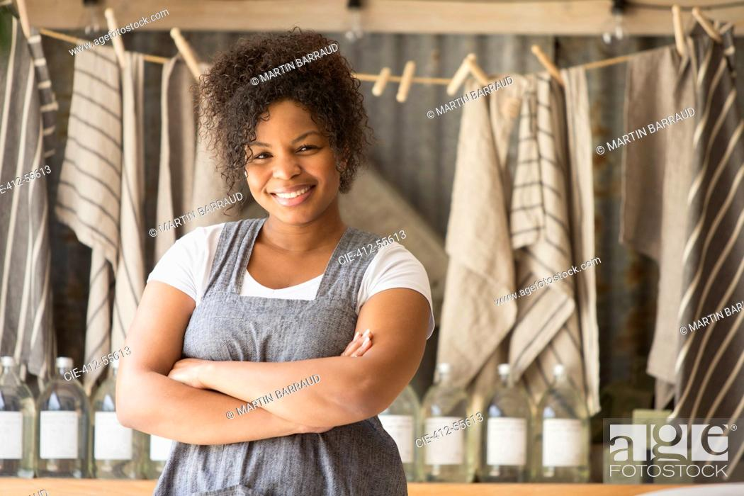 Stock Photo: Portrait confident female shop owner with arms crossed.