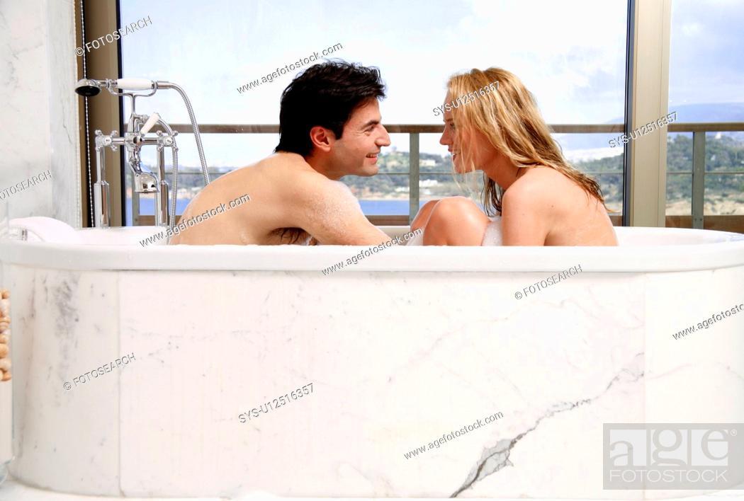 Stock Photo: Couple enjoying bubble bath together.