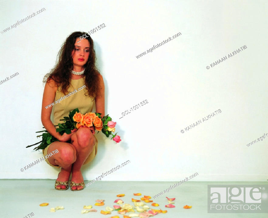 Stock Photo: Woman cowering on the floor.