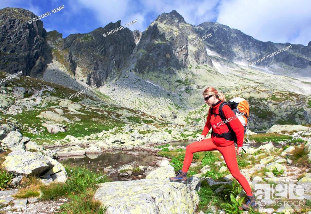 Stock Photo: woman backpacker at Five Spis Tarns, Vysoke Tatry High Tatras, Slovakia.