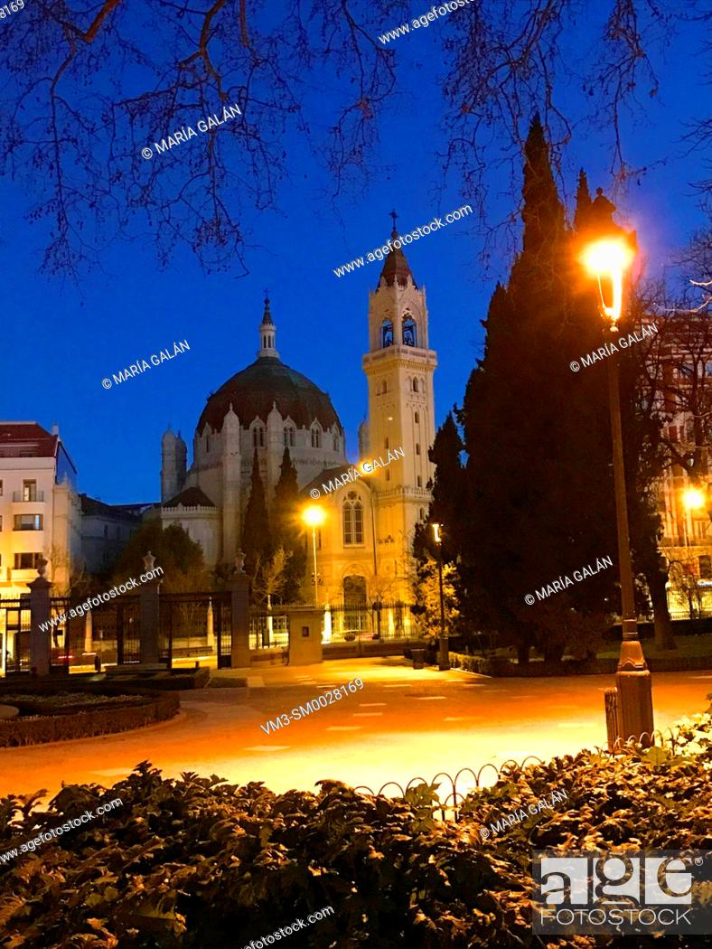 Stock Photo: San Manuel y San Benito church from El Retiro park, night view. Madrid, Spain.