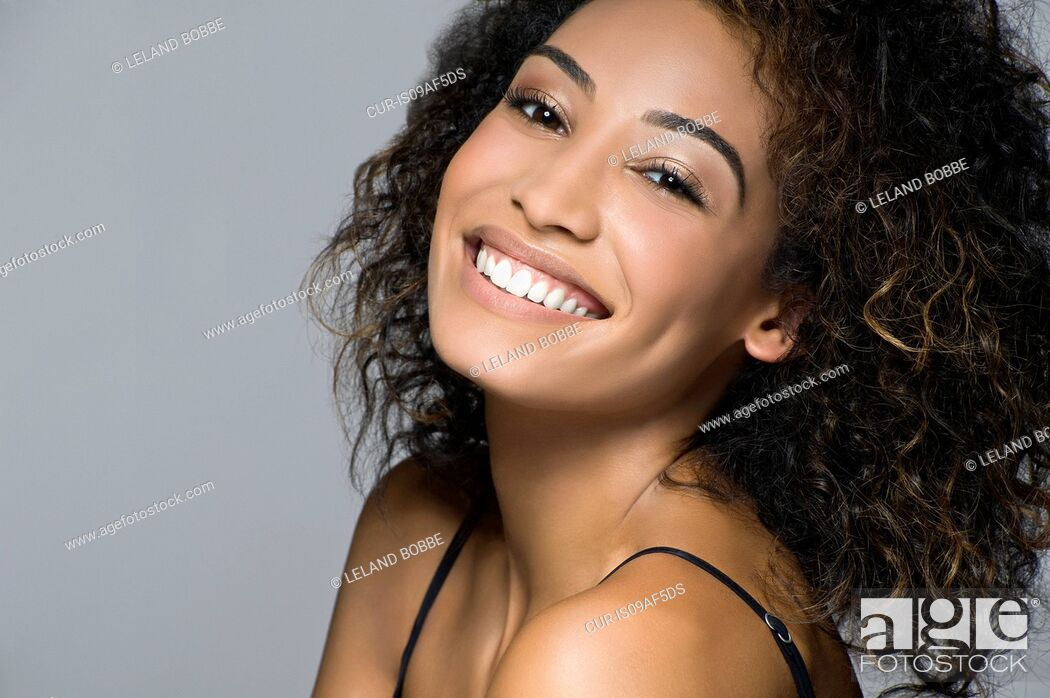 Stock Photo: Studio portrait of beautiful happy young woman.