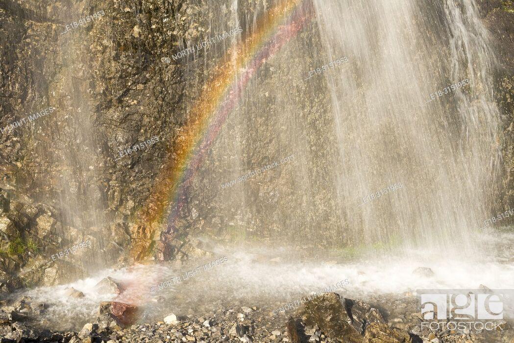 Stock Photo: Canada, Alberta, Crowsnest Pass. Rainbow on waterfall near Emerald Lake. Close to the BC Alberta border.