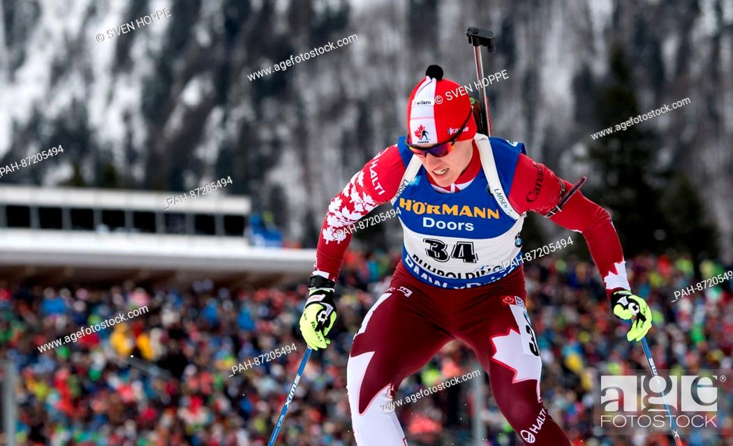 Stock Photo: The biathlon athlete Christian Gow from Cananda participates in the men's 10 km sprint within the Biathlon Worldcup at the Chiemgau Arena in Ruhpolding, Germany.