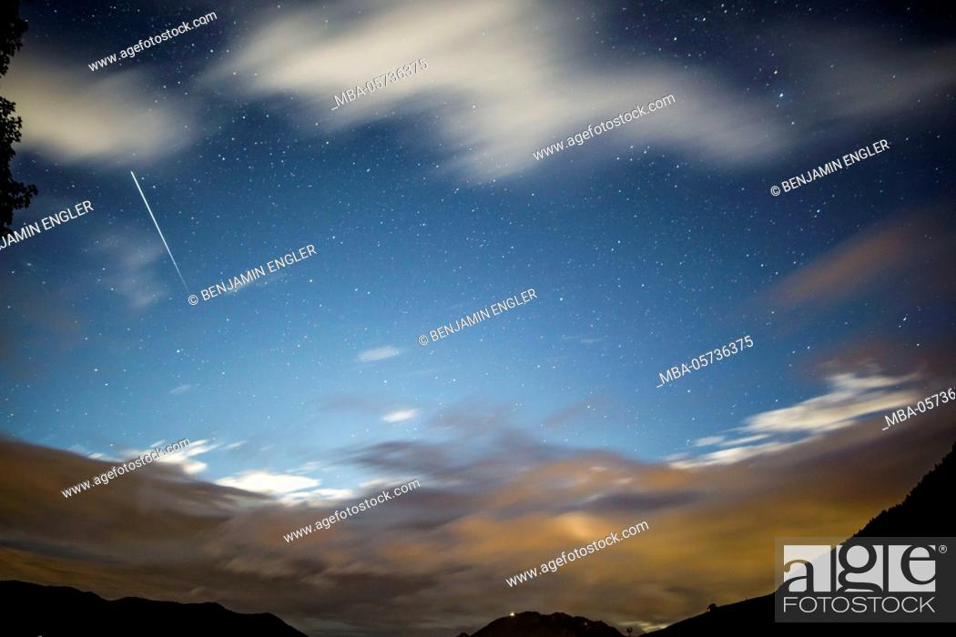 Stock Photo: Long-exposure photography shooting star and clouds.
