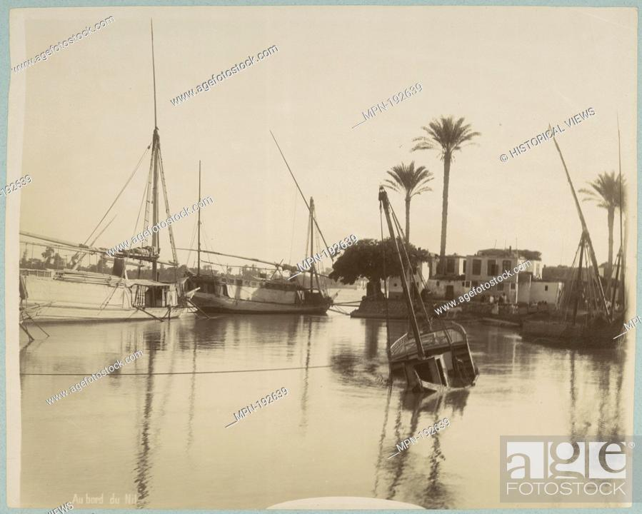 Stock Photo: Au bord du Nil. Egypt, a collection of views: photographs. Date Created: 1860 - 1869 (Inferred). Egypt Nile River Waterfronts - Egypt Sailboats - Egypt.