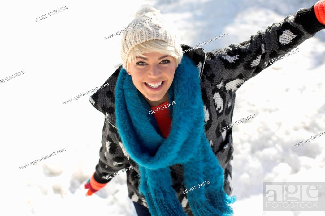 Stock Photo: Portrait of smiling woman in snow.