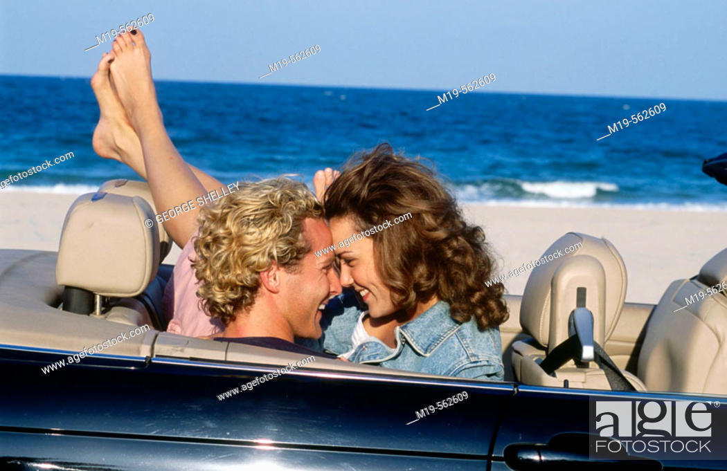 Stock Photo: romantic couple in a covertible.