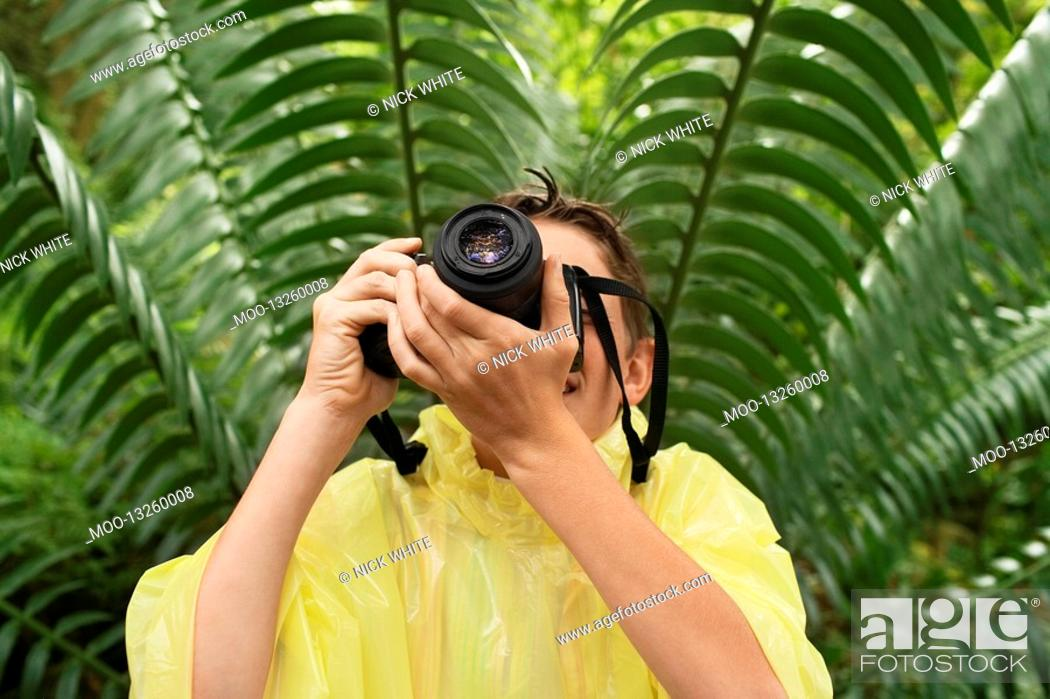 Stock Photo: Boy Taking Photos in Forest.
