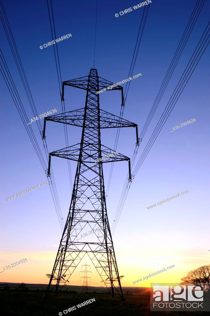Stock Photo: An electricity pylon of the National Grid in Wales at sunset.