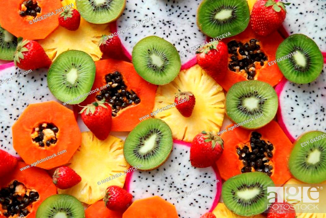 Stock Photo: Mixed ripe and fresh fruits and berries close up for background. Dragon fruit, pineapple, papaya, kiwi, strawberry.