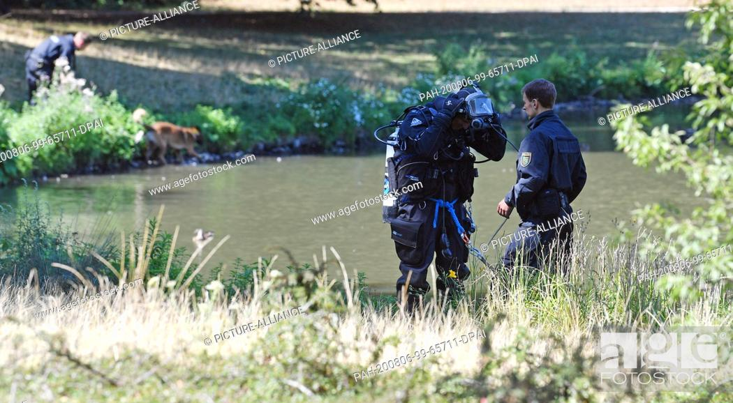 Stock Photo: 06 August 2020, Saxony, Leipzig: Forensics and the diving group of the police are searching for traces at the island pond in Clara-Zetkin-Park.