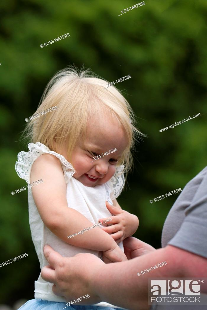 Stock Photo: A mother and her toddler daughter outdoors.