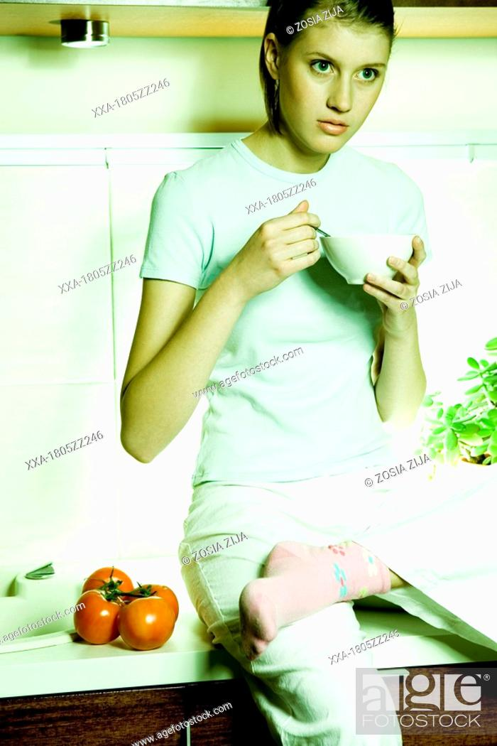 Stock Photo: young woman with a cup.