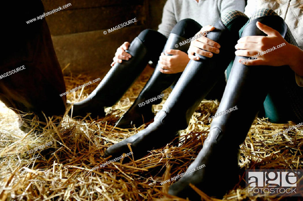 Stock Photo: Two people wearing riding boots.