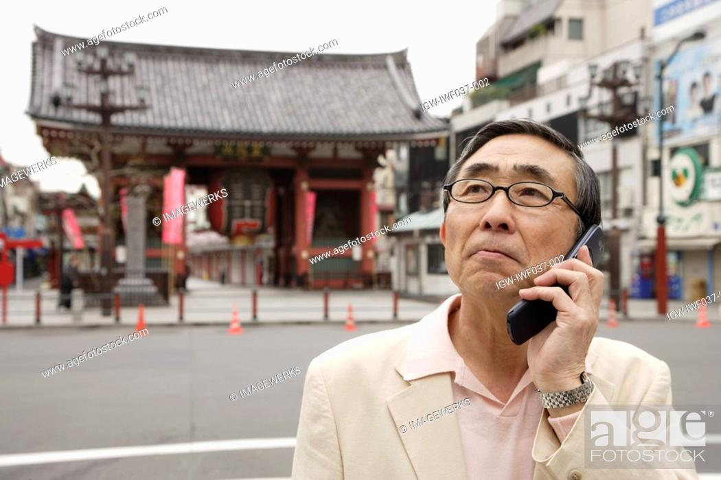 Stock Photo: View a senior man using mobile phone.