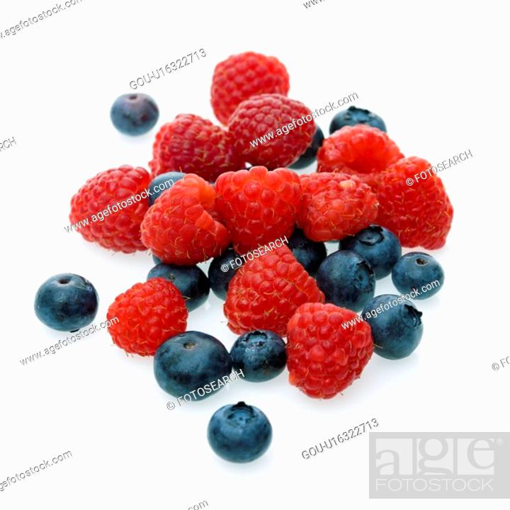 Stock Photo: Mixed blueberries and raspberries on white background.