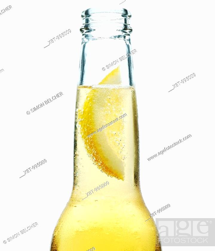 Stock Photo: Lemon in a Beer Bottle.