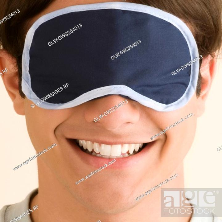 Stock Photo: Close-up of a young man wearing an eye mask.
