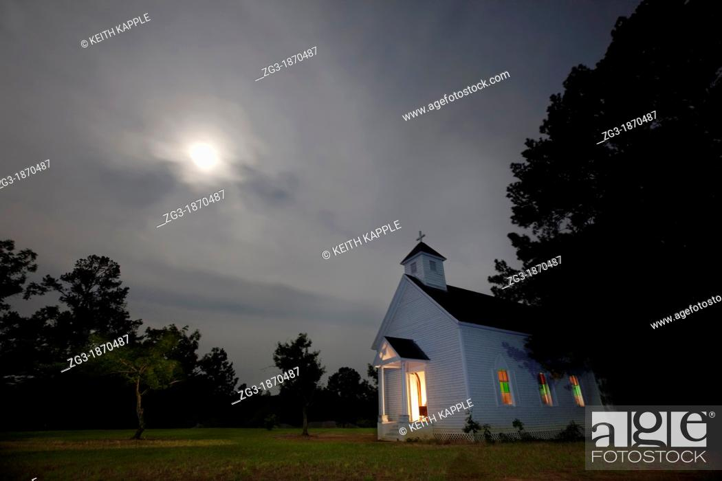 Stock Photo: Abandoned Old Church at night, with moon glow halo, Rusk, Texas.