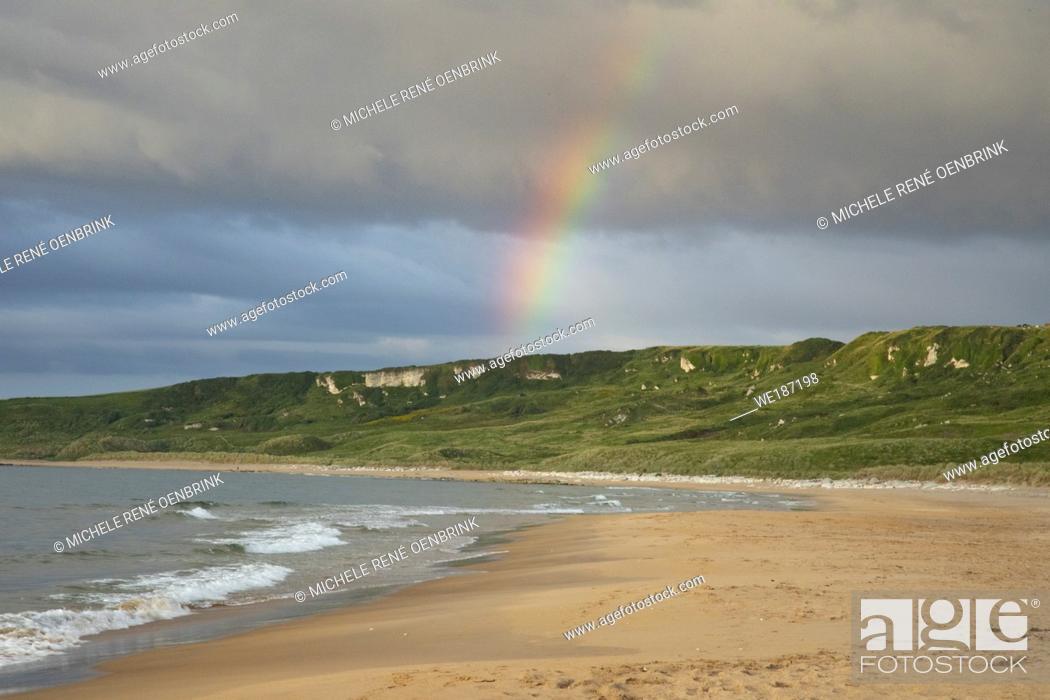 Stock Photo: Rainbow at Whitepark Bay Beach in Northern Ireland.