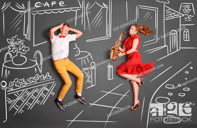Stock Photo: Love story concept of a romantic couple against chalk drawings background. Woman playing the sax on the street for her lover.