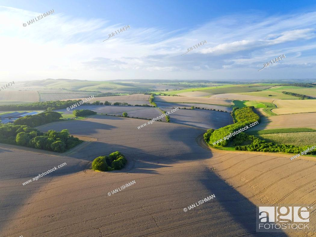 Stock Photo: Aerial View Of Farm Fields With Blue Sky.