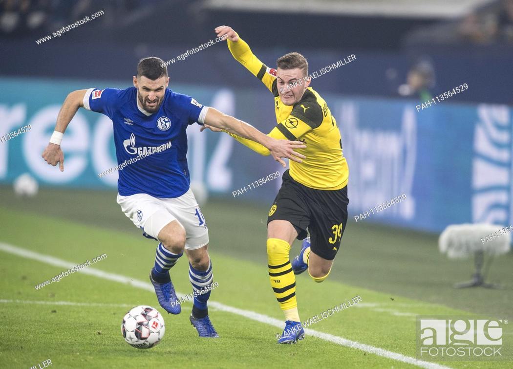 Stock Photo: Jacob BRUUN LARSEN r. (DO) in action versus Daniel CALIGIURI (GE), duels, Soccer 1.Bundesliga, 14.matchday, FC Schalke 04 (GE) - Borussia Dortmund (DO) 1: 2.