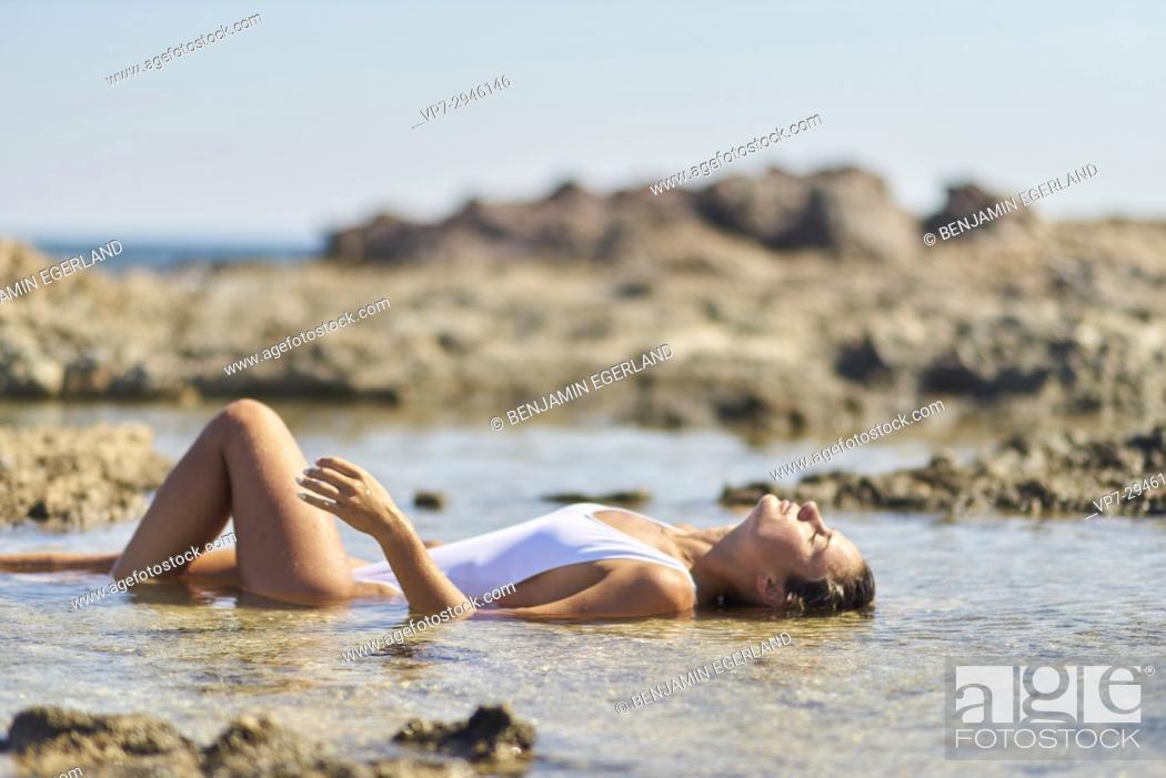 Stock Photo: attractive woman enjoying bath in healthy sea water. Dutch ethnicity. At holiday destination Chrissi Island, Crete, Greece.