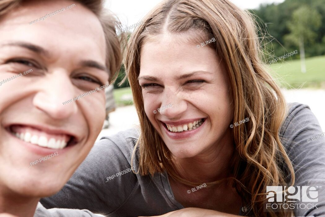Stock Photo: Young couple smiling a lot.