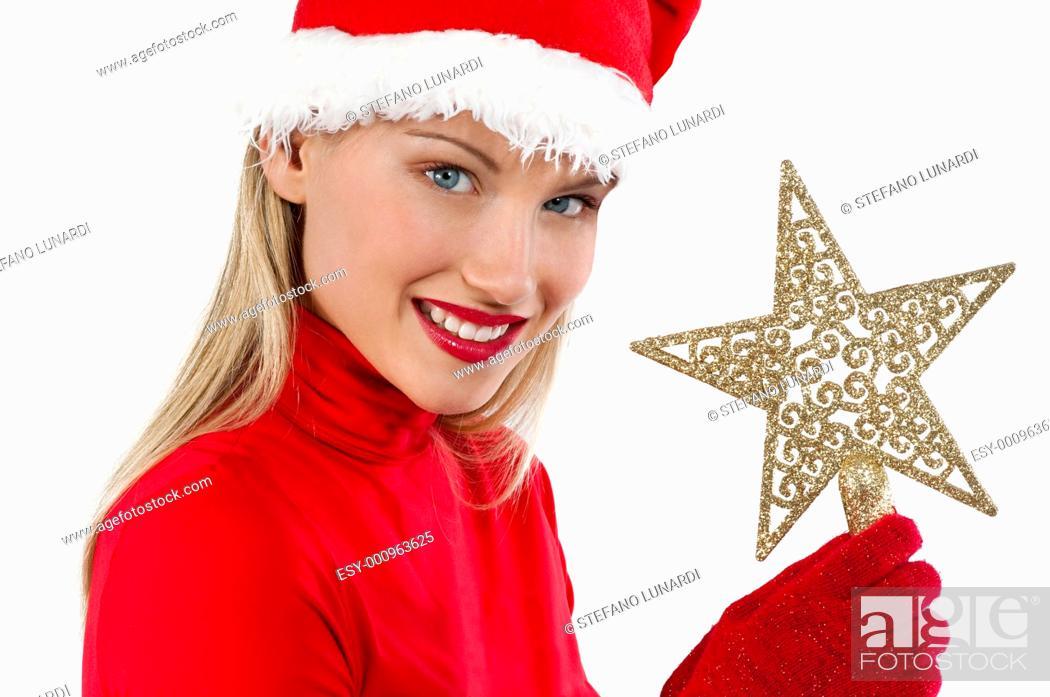 Stock Photo: Beautiful Santa girl on white holding a Christmas decoration.