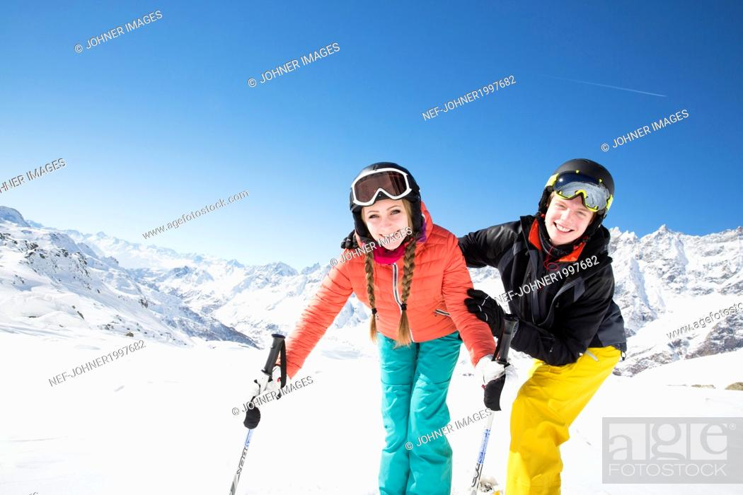 Photo de stock: Happy young couple looking at camera.