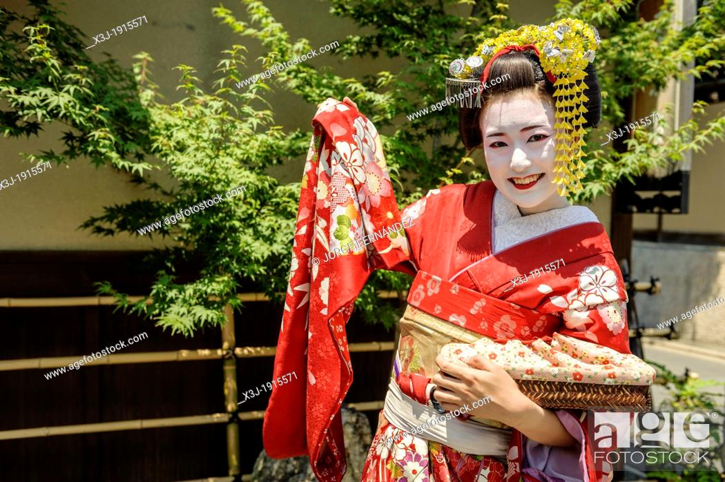 Stock Photo: Tourist dressed as Maiko on the streets of Kyoto, Japan, Asia.